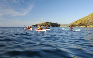 Kayakers with Peel Castle in the background