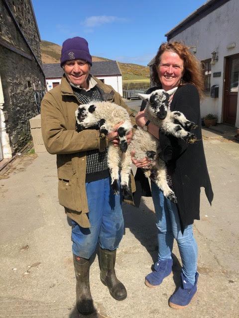 John and Fiona holding lambs